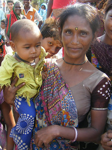 Indian mother holding her child