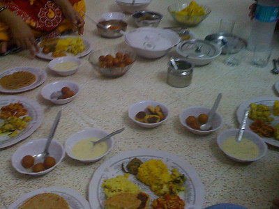 A Gujarati meal, with many dishes including gulab jamin