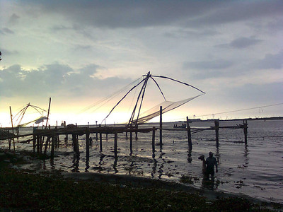 Kerala fisherman with the chinese fishing nets